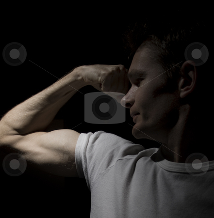 Dramatic power pose  stock photo, A man in a power pose, symbolising strength by Jandrie Lombard