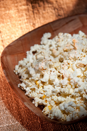 Pop Corn stock photo, Bowl of tasty  popcorn on a rustic texturized background by Jose Wilson Araujo