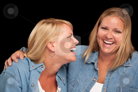 Two Beautiful Sisters Laughing stock photo, Two Beautiful Sisters Laughing Isolated on a Black Background. by Andy Dean