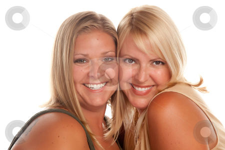 Two Beautiful Smiling Sisters Portrait stock photo, Two Beautiful Smiling Sisters Portrait Isolated on a White Background. by Andy Dean