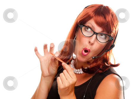 Red Haired Retro Receptionist stock photo, Red Haired Retro Receptionist Filing Her Nails Isolated on a White Background. by Andy Dean