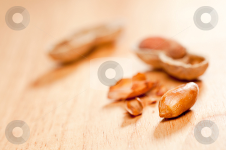 Peanuts on Wood Background stock photo, Peanuts on Wood Background with Dramatic Lighting. by Andy Dean