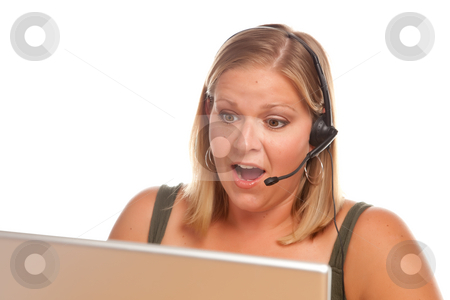 Attractive Shocked Customer Support Woman stock photo, Attractive Shocked Businesswoman Talks on Her Phone Headset. by Andy Dean