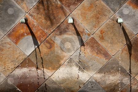 Stone Wall Fountain Abstract stock photo, Beautiful Stone Wall Water Fountain Row Abstract. by Andy Dean