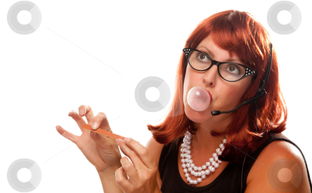 Red Haired Retro Receptionist stock photo, Red Haired Retro Receptionist Blowing a Bubble Isolated on a White Background. by Andy Dean