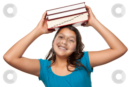 Pretty Hispanic Girl with Books on Her Head stock photo, Pretty Hispanic Girl with Books on Her Head Ready for School Isolated on a White Background. by Andy Dean
