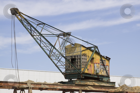 Old Crane stock photo, Old crane with a wooden cabin and rusty metal parts by Inge Schepers