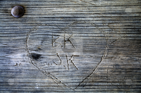 Heart carved into wood with initials stock photo, Heart carved into wood with initials by W. Paul Thomas