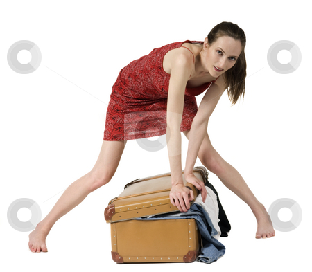 Travelling stock photo, Beautiful girl pack a suitcase, isolated on hite by Desislava Draganova