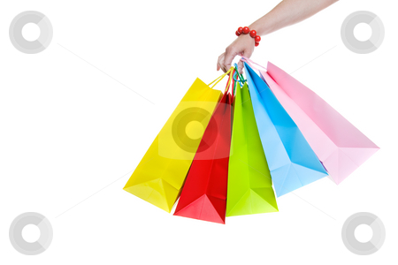 Shopping stock photo, A female hand holding colorful shopping bags by Steve Mcsweeny