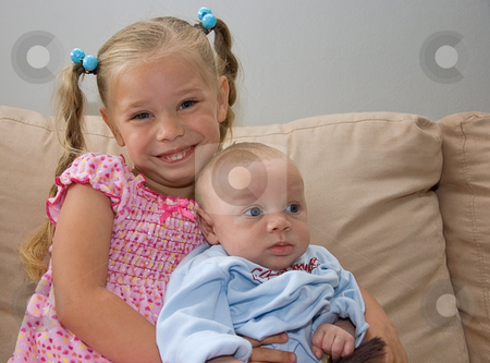 Siibling Baby Brother and Sister stock photo, These siblings are sitting together with baby brother being 2 months of age, and sister is 4 years old. by Valerie Garner