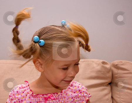 Little Girl With Pigtails Flying stock photo, This little 4 year old girl is swinging her head to make her braided pigtails fly about. by Valerie Garner