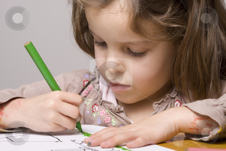 Girl Drawing stock photo, Little girl drawing a picture by Jandrie Lombard
