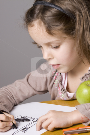 Little girl drawing stock photo, Little girl drawing with a green apple by Jandrie Lombard