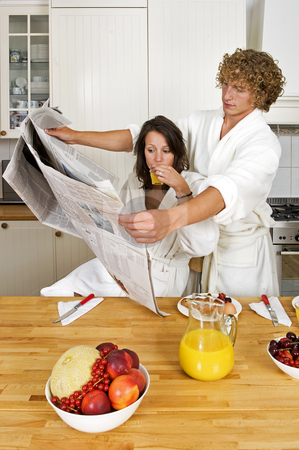 Reading together stock photo, Young couple reading the newspaper together in an unusual way by Corepics VOF