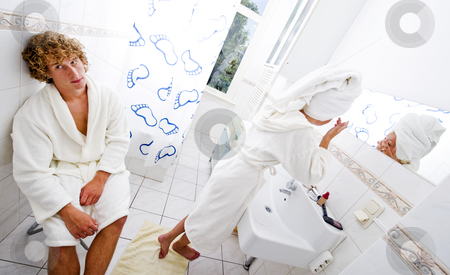 Sharing a bathroom stock photo, A young couple sharing a bathroom by Corepics VOF
