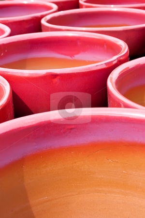Red Pots stock photo, A collection of bright red and purple glazed flower pots by Keith Wilson