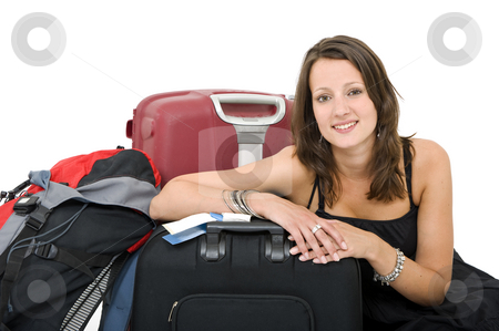 Travelling woman stock photo, Young brunette posing amidst her luggage, smiling by Corepics VOF