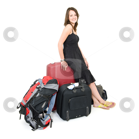 Travelling woman stock photo, Young brunette woman, leaning on a suitcase, surrounded by more luggage by Corepics VOF