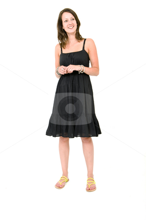 Woman - Natural stock photo, Full body portrait of a young brunette woman in a black summer dress, smiling, unforced by Corepics VOF