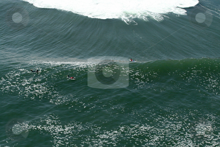 Surfer about to launch in a wave, aerial view stock photo, Aereal view of surfers during a contest in the Gringo wave in Arica, Chile by Philip Muller