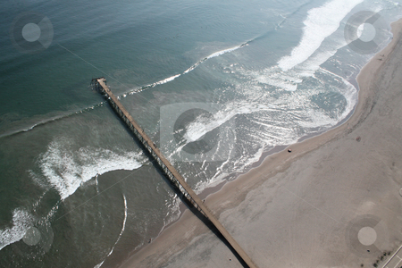 Aerial view of an old pier stock photo, Aerial view of an old Pier on Machas Beach in Arica, Chile by Philip Muller