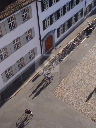 Bikes In Basel stock photo, Cyclist throws a shadow seen from the church tower by Philip Muller