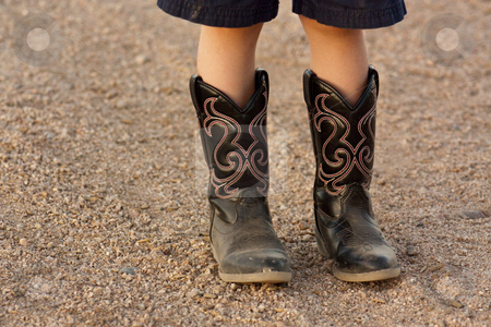 Kids Boot stock photo, A kids boots, standing on the gravel by Patrick Noonan