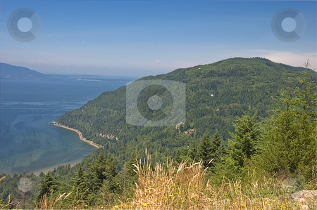 Seascape View From Samish Overlook stock photo, This seascape view is taken from Samish Overlook in Washington state.  Ocean shows patterns of current in the water and the shore and forested areas. by Valerie Garner