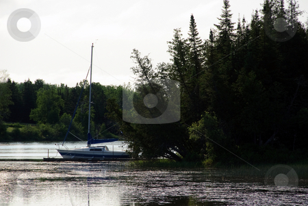 Quiet River and Boat stock photo, Picture of a quiet river early in the morning with a sailing boat by Alain Turgeon