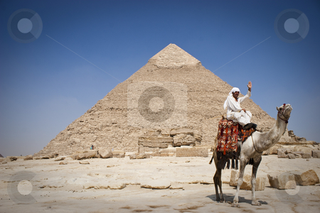 The Pyramid of Khafrae stock photo, The Pyramid of Khafrae is the second largest of the Ancient Egyptian Pyramids of Giza and the tomb of the fourth-dynasty pharaoh Khafre (Chephren in Greek), The pyramid has a base length of 215.25 m (706 ft) and originally rises to a height of 143.5 m (471 ft). The Pyramid is made of Limestone blocks (weighing more than 2 tons each). The slope of the pyramid rises at an 53??? 10' angle, steeper than its neighbor Khufu???s pyramid which has an angle of 51???50'40