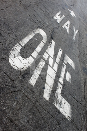 One Way stock photo, One way sign painted on the street ground. by Henrik Lehnerer