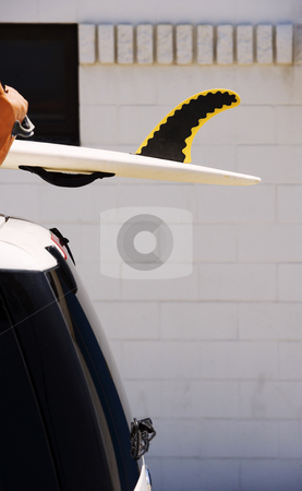 Fin on a rescue surfboard stock photo, Fin on a rescue surfboard attached to SUV roof by Scott Griessel