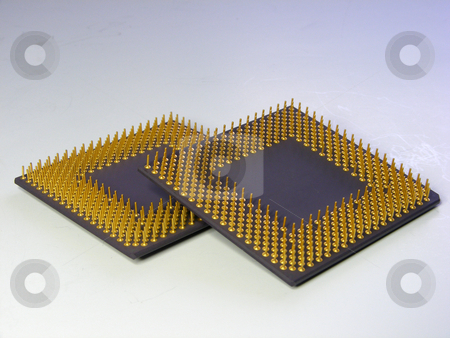 Cpus 2 stock photo, A pair of CPUs with gold plated pins by Stuart Atton