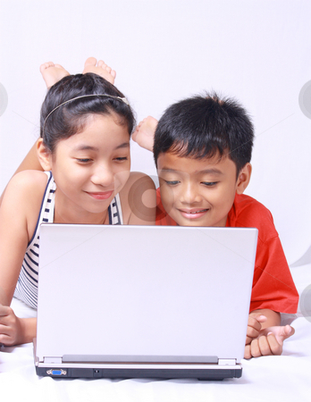 Computer kids stock photo, Asian kids sharing and enjoying laptop computer by Claro Alindogan