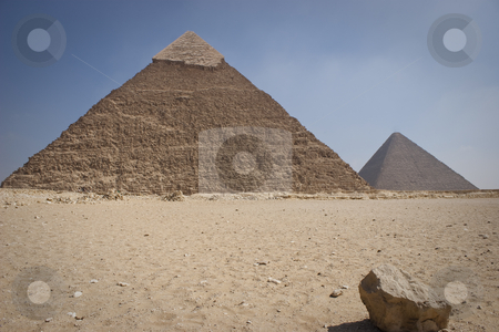 The Pyramid of Khafrae stock photo, The Pyramid of Khafrae is the second largest of the Ancient Egyptian Pyramids of Giza and the tomb of the fourth-dynasty pharaoh Khafre (Chephren in Greek), The pyramid has a base length of 215.25 m (706 ft) and originally rises to a height of 143.5 m (471 ft). The Pyramid is made of Limestone blocks (weighing more than 2 tons each). The slope of the pyramid rises at an 53 by Amr Hassanein