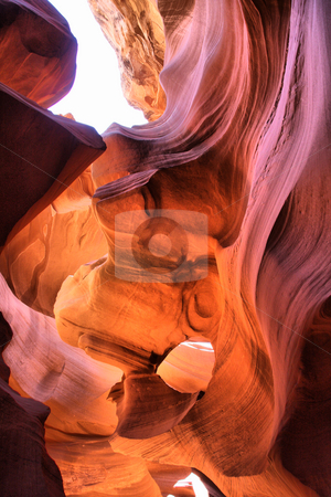 Antelope Canyon Ray of light stock photo, Perfect lines and colors of the sandstone walls inside the Antelope Canyon with *ray of lights* by Martin Reisacher
