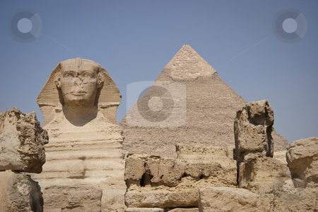 The Sphinx stock photo, The Great Sphinx of Giza is a statue of a reclining lion with a human head that stands on the Giza Plateau on the west bank of the Nile, near modern-day Cairo, in Egypt. It is the largest monolith statue in the world, standing 73.5 m (241 ft) long, 6 m (20 ft) wide, and 20 m (65 ft) high. It is the oldest known monumental sculpture, built on the third millennium BC.
