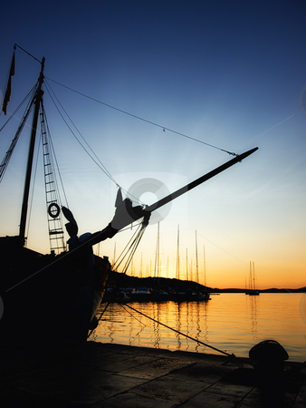 Port in the sunset stock photo, Quiet evening in some Adriatic port with splendid colors. by Sinisa Botas