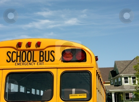 School bus stock photo, School bus in suburban setting room for text by Cora Reed