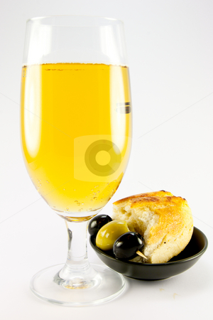Glass of Lager with Crusty Bread and Olives stock photo, Glass of lager with three green olives and piece of crusty bread in a small black bowl on a plain background by Keith Wilson