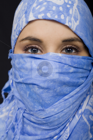 Ethnic woman stock photo, Ethnic blue eyes woman on black isolate portrait by Marc Torrell