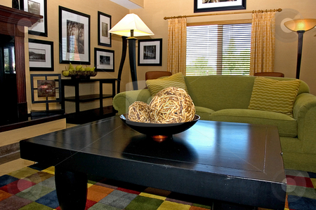 Contemporary Interior Room stock photo, This beautifully decorated room is a contemporary style well lit and a patch work area carpet. by Valerie Garner