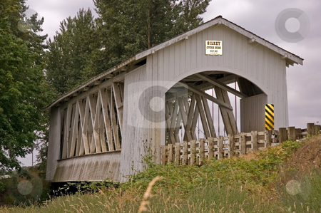 White Covered Bridge stock photo, This photo is a white covered turn of the century historic bridge in a small rural farming area. by Valerie Garner
