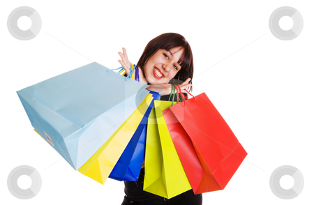 Smiling shopper stock photo, A happy mixed race woman with many shopping bags by Steve Mcsweeny