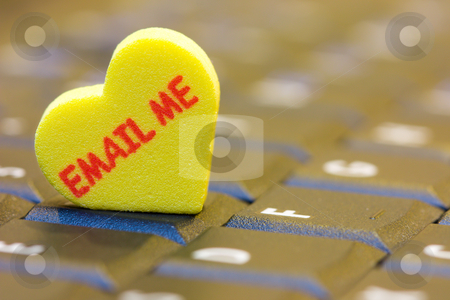 Email me stock photo, A heart shape with 'email me' word on a computer keyboard. by Hieng Ling Tie