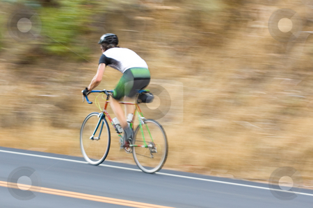 Man cyclist racing past stock photo, A man cyclist racing by at high speed by Hieng Ling Tie