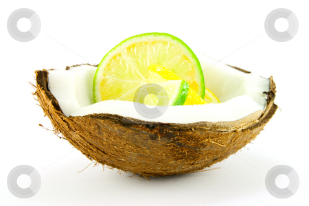 Lemon and Lime Slice in a Coconut stock photo, Slice of lemon and lime in a half coconut on a white background by Keith Wilson