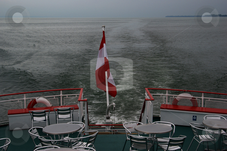 Austrian flag on the aft from a line ship stock photo, ???sterreichische Flagge am Heck eines fahrenden Linienschiffes / Austrian flag on the aft from a line ship by Thomas K?