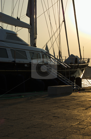 Sailboat in the Sun stock photo, Sailboat docked in Venice Italy by George Fairbairn